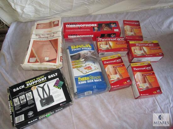Lot of Thermacare heating pads, back support etc.