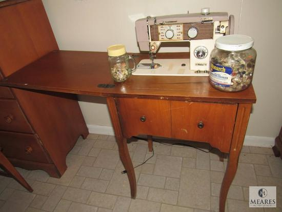 Vintage Fleetwood sewing machine in wood cabinet with wooden stool