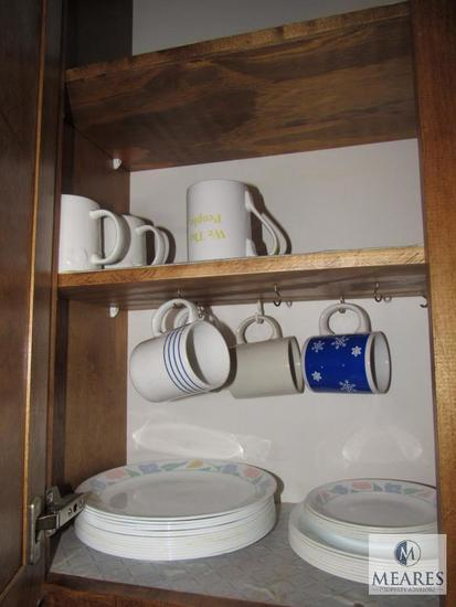 Contents of kitchen cabinets includes china mugs plates bowls and saucers