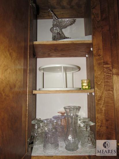 Contents of kitchen cabinet includes glass goblets base and plastic angel