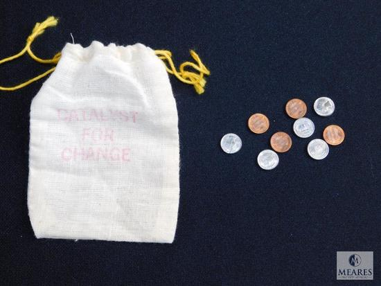 """Miniature coin replicas pennies, dimes, nickels, quarters in bag """"Catalyst for change"""""""