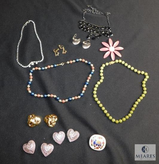 Lot of Vintage costume jewelry includes button coves, earrings, necklaces, etc.