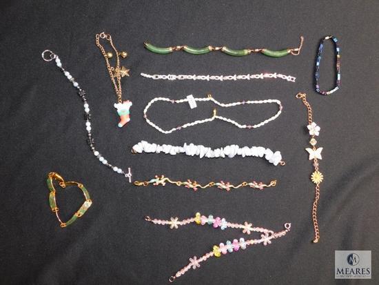 Assorted costume bracelets- some broken