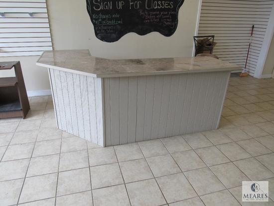 J-shaped checkout counter