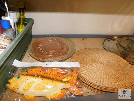 Shelf lot wicker placemats glass platters and car cleaning supplies
