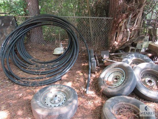 Lot yard Contents- Old truck fender, Tires & wheels, Cement Blocks, Black PVC pipe, metal scrap +