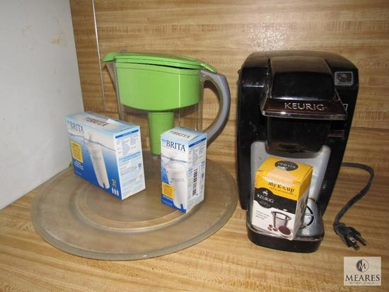 Lot Keurig Coffee Maker, Brita Water Jug and Filters, and Glass turntable