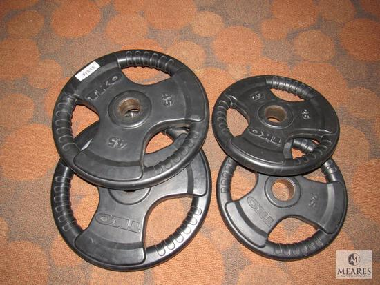 Lot of 4 TKO Tri-Grip Weight plates: (2) 45 and (2) 25 lbs plates