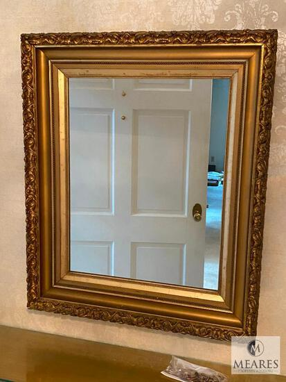 Mirror with gold-colored wooden frame