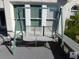 Metal framed outdoor swing and side table