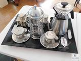 Tray with Assorted Tea Strainers, Kettle, Candle Holders and Tea cups and Saucers