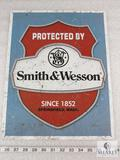 Smith and Wesson reproduction tin advertising sign