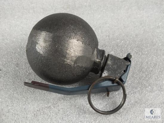 Insert demilled Baseball type hand grenade.