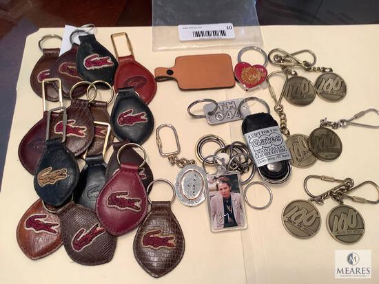 Large Lot of IZOD/Lacoste Key Rings and Others