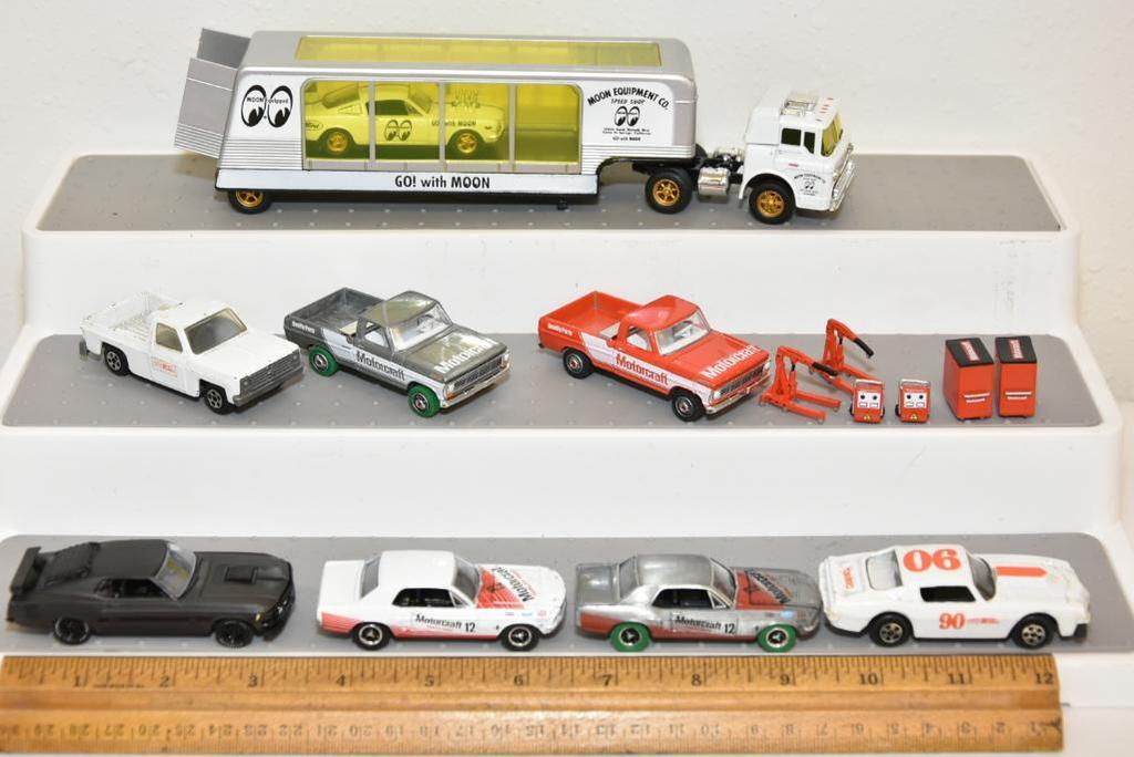 SCALE: 1:64 HAULER AND CARS 1- M2 MACHINES MOON EQUIP CO HAULER AND CAR, 1- MOTORCRAFT CAR/TRUCK