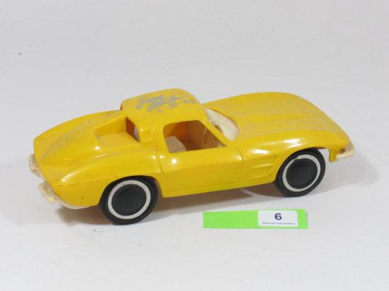 "Yellow 6.5 Inch 1960s Decade Plastic Corvette Signed ""Larry Shinoda"" 1-21-93"
