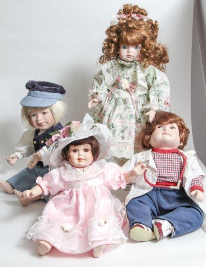 Group of 4: 16-inch Porcelain Dolls