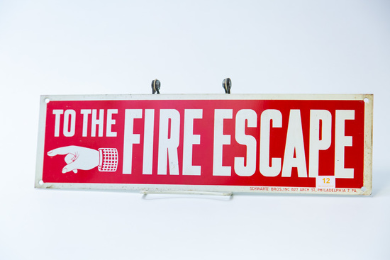 """Metal """"To The Fire Escape"""" sign"""