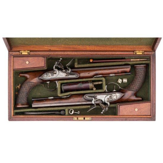 Cased Set of Saw Handle Flintlock Dueling Pistols by Oakes of London