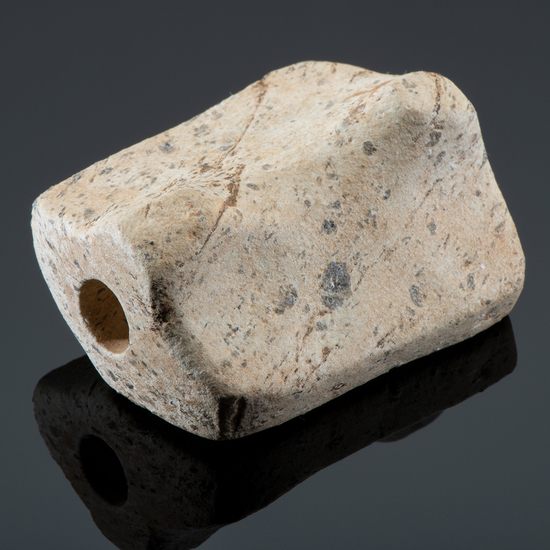 An Unfinished Gneiss Preform Hooked Bannerstone