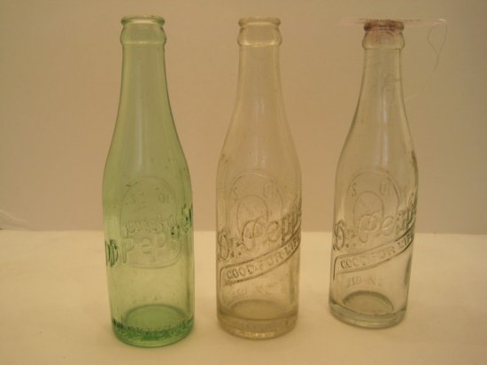 "2 Clear/Green Dr. Pepper 6 1/2oz. Bottles w/ Clock ""Drink A Bite To Eat at 10, 2 & 4"" Slogan"