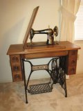 Early Singer Treadle Cast Iron Caster Base Sewing Machine in Quarter Sawn Oak Cabinet
