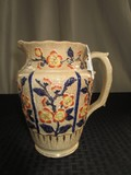 Gilted/Crazed Pitcher w/ Blue/Red Floral Patterns, Curled Handle