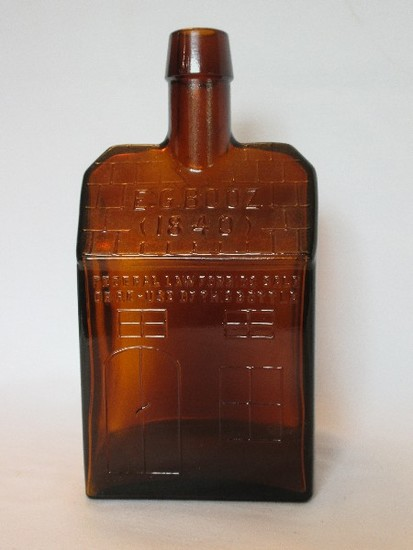 E.G. Booz Amber Pressed Glass Old Cabin Design Bottle