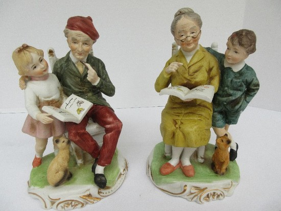 Pair - Bisque Figurines Elderly Man & Woman Reading To Grandchildren