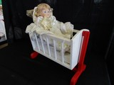 Vintage Doll Porcelain Head/Hands/Feet in Ornate Dress in Wooden White/Red Doll Cot