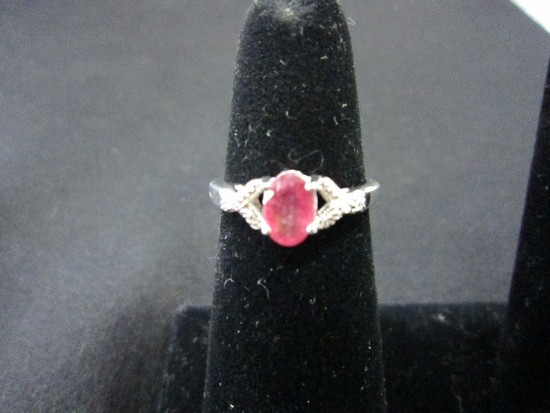 925 Stamped Ring w/ Ruby in 4 Claw Setting
