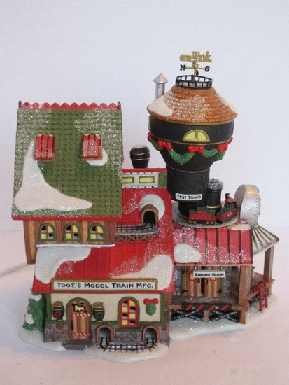 "Department 56 North Pole Series Heritage Village Collection ""Toot's Model Train Mfg."""
