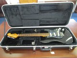 Fender Stratocaster Guitar Iridescent Pearl on Black Wood Body, Wood Neck/Head