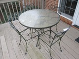 Black Metal Patio Table w/ Glass Top Curled/Scroll Design, Leaf Pattern Trim w/ 4 Chairs