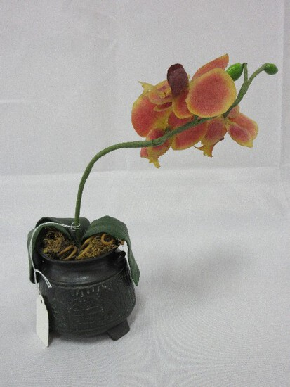 Silk Orchid in Ceramic Black Footed Pot Embossed Design Antiqued Patina