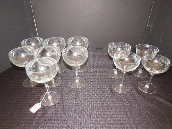 "Lot - Floral/Leaf Etched 7 Champagne Saucers, 6 3/4"" H Floral/Etched Cups/Glasses"