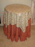Partical Board Side Table w/ Floral & Mauve Ruffled Linen Table Clothes