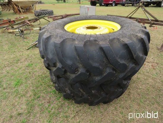 (2) Goodyear 19.5-24 tires on JD wheels