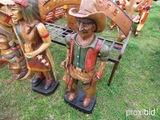 Wood cowboy statue