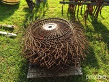 Pallet of hay rake wheels