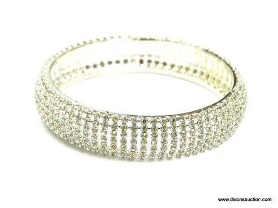 "RHINESTONE SET 7 ROWS WIDE MEASURES 5/8"" WIDE 2.5"" ACROSS THE INSIDE AND IS IN EXCELLENT CONDITION."