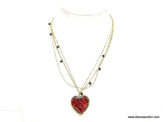 VERY COLLECTIBLE SIGNED BETSY JOHNSON DESIGNER HEART GOLD TONE NECKLACE. FEATURES 3 DIFFERENT GOLD