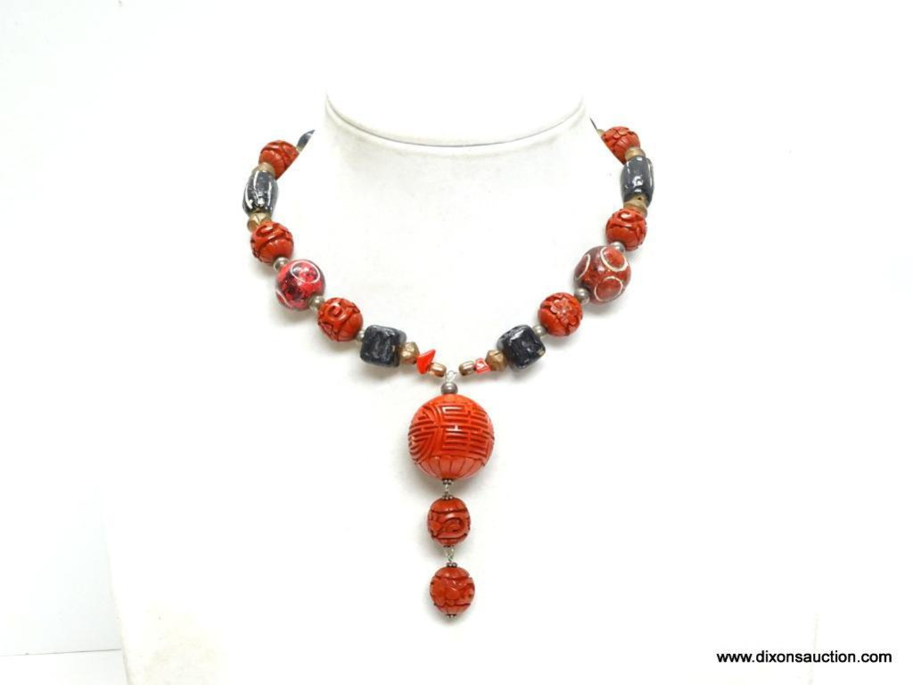 "VINTAGE CARVED CINNABAR ROUND BALL OF LIFE DROP PENDANT NECKLACE. 17"" LONG. PENDANT HAS 3"" DROP."