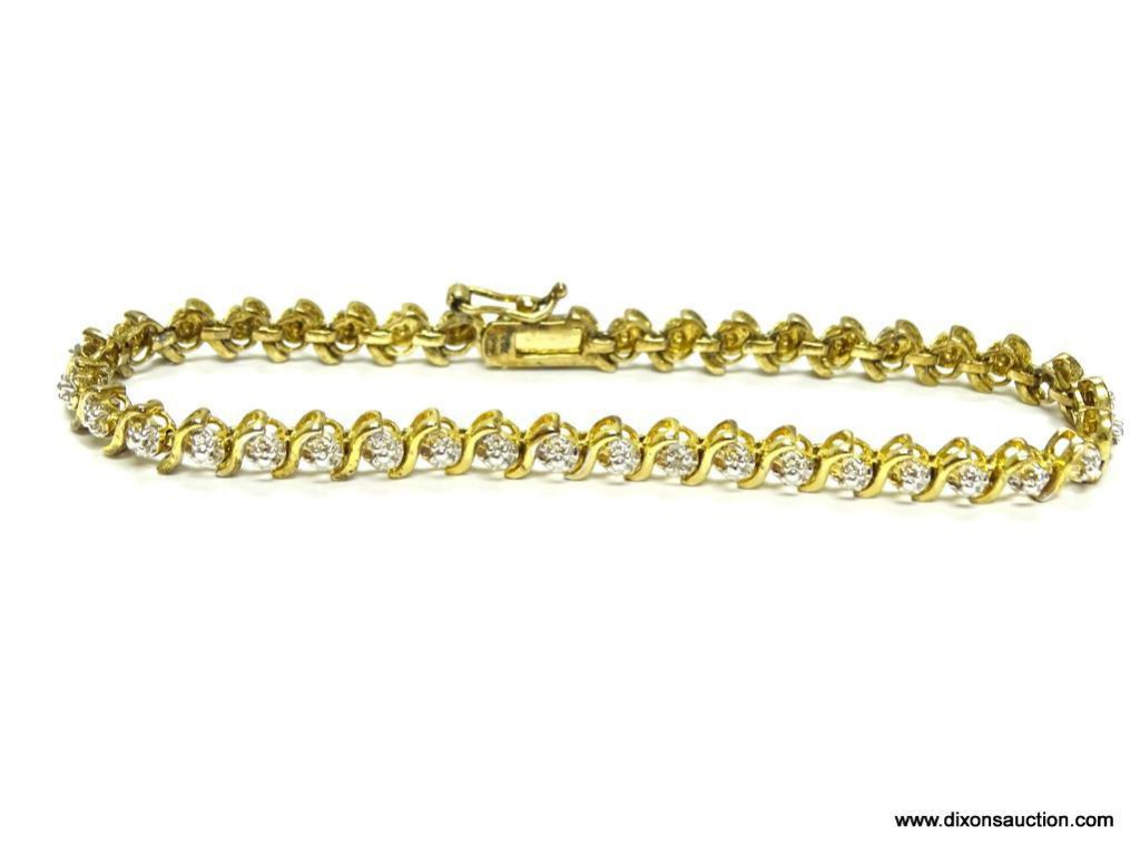 "STERLING SILVER WITH GOLD VERMEIL TENNIS BRACELET. 7.5"" LONG."