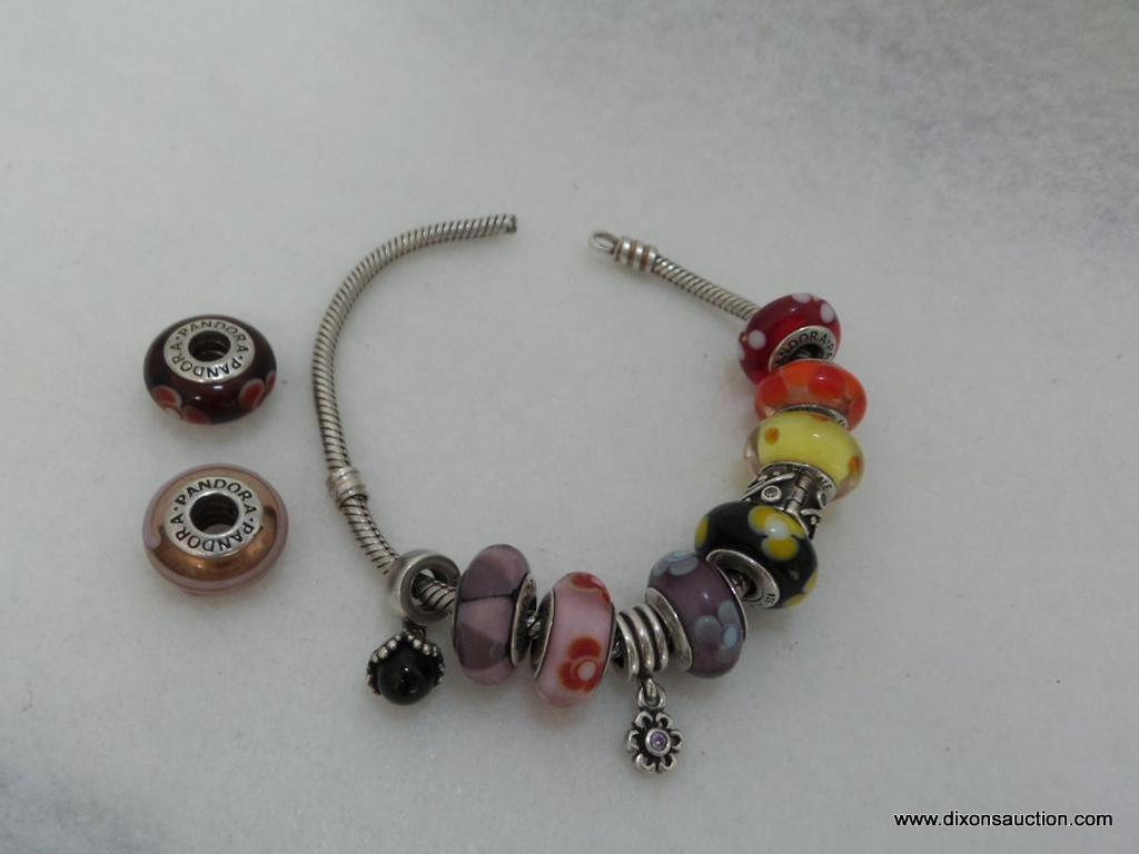 PANDORA STERLING SILVER BRACELET WITH NINE PANDORA MURANO CHARMS AND ASSORTED SPACERS. BRACELET