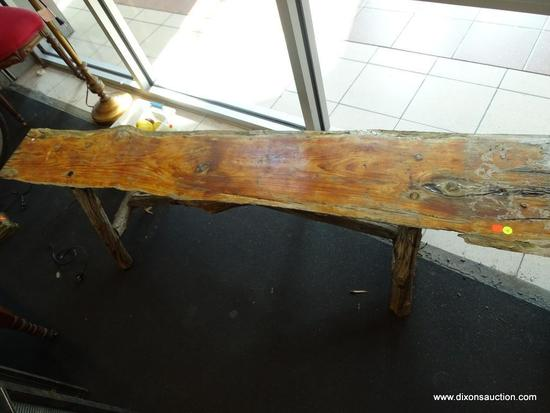 (WIN) PRIMITIVE WOODEN BENCH; SINGLE LONG PLANK OF KNOTTY PINE, PEG CONSTRUCTED, WITH LIMB-LIKE LEGS