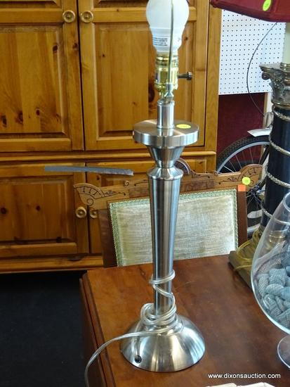 (WIN) BRUSHED SILVER COLORED MODERN TABLE LAMP; COMES WITH HARP AND FINIAL. ALSO HAS A BULB MARKED