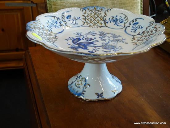 (WIN) WHITE AND BLUE PORCELAIN PEDESTAL DISH; SCALLOPED EDGES WITH PIERCED PANELED BORDER, WHITE