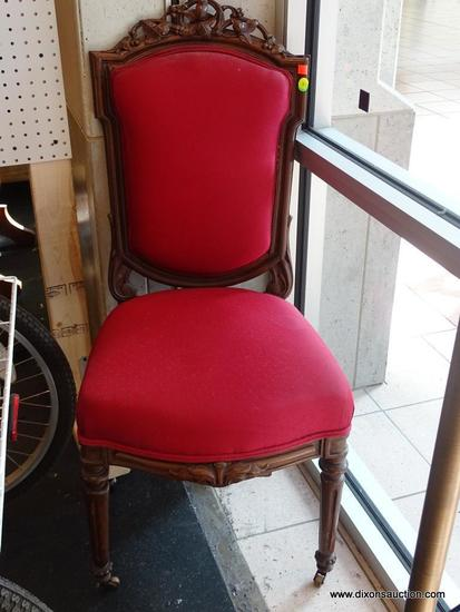 (WIN) RED UPHOLSTERED VICTORIAN SIDE CHAIR; WELL-CARVED VINE AND BERRY PATTERNED BOWED CRESTRAIL,
