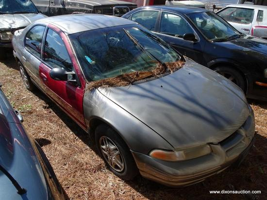 1999 GREY DODGE STRATUS; VIN 1B3EJ46X6XN505943. THIS VEHICLE WAS ABANDONED AT A GAS STATION WITH A